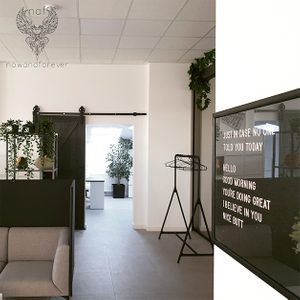 office with sliding doors, black doors, black and white interior design