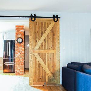 rustic wooden door, sliding door made of brushed wood, barn door, sliding door with a horseshoe, sliding door to the kitchen