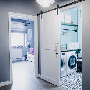 white sliding door, sliding door system, modern farmhouse, laundry room door, sliding door in the hallway, grey colors, black decorative elements, mosaic on the floor