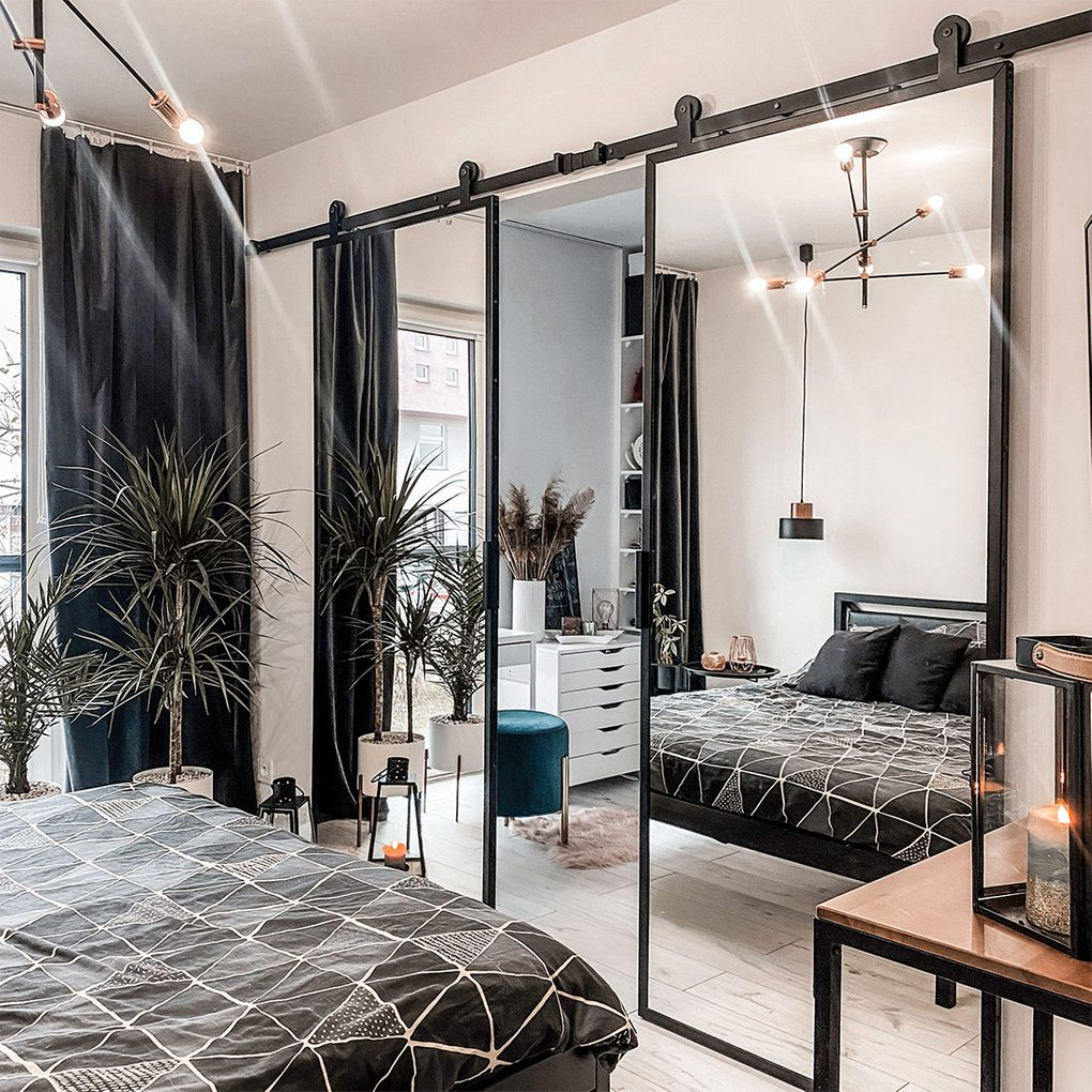double sliding door with mirror, industrial lamp, black accessories in bedroom, walk-in wardrobe, modern bedroom, metal bed frame, metal hanging lamp