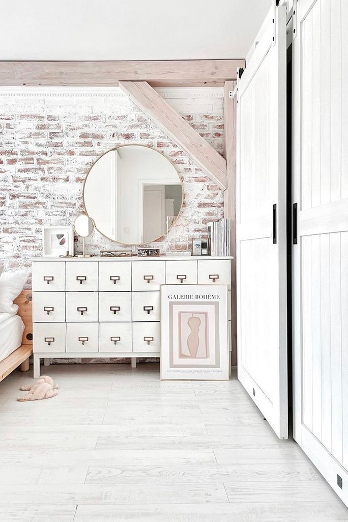 white bedroom design, brick on the wall in the bedroom, brick wall painted in white, rustic bedroom, white chest of drawers in bedroom, bedroom with an alcove